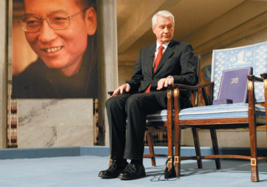 Nobel Committee Chairman Thorbjørn Jagland looking at the empty chair reserved for the Nobel Peace Prize winner Liu Xiaobo, December 10, 2010. According to news reports, since the award ceremony, the Chinese words for 'empty chair' have been banned on the Chinese Internet and some bloggers who have used the phrase or posted images of empty chairs have had their sites blocked.