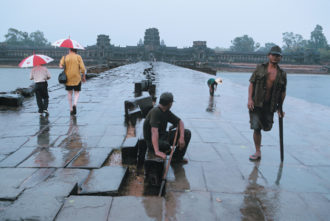 The causeway across the moat at Angkor Wat; photograph by Steve McCurry