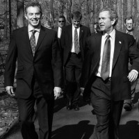 Tony Blair and George W. Bush with their aides at Camp David, Maryland,