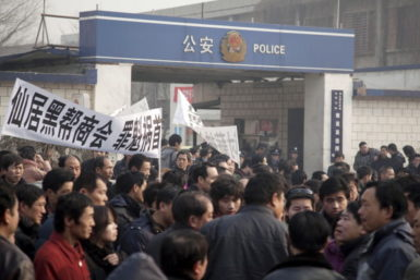 A protest outside a police station, Beijing, December 22, 2010