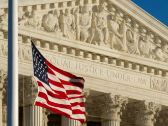 The US flag flies at half-staff outside the US Supreme Court, January 9, 2011, in memory of the victims of the January 8 shootings in Tucson, Arizona