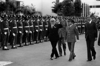 Habib Bourguiba, the founder of the Tunisian Republic and predecessor of recently deposed Zein el-Abedine Ben Ali, viewing a military parade at an Arab Summit meeting, Rabat, Morocco, 1974