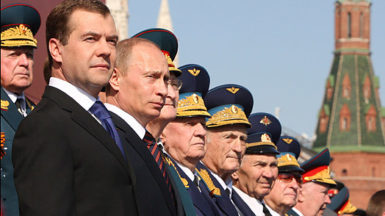 Russian President Dmitry Medvedev and Prime Minister Vladimir Putin stand with World War II veterans during the annual Victory Day parade on Moscow's Red Square, 2009