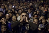 Anti-government protesters watching Egyptian President Hosni Mubarak making a televised statement, Tahrir Square, February 10, 2011
