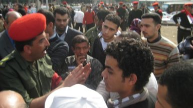 A military officer telling protesters to go home, Cairo, February 22