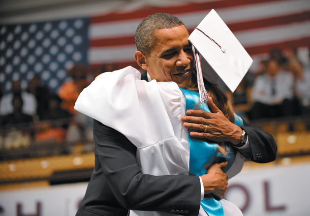 President Obama with a graduate of Kalamazoo Central High School in Michigan after he delivered the commencement address, June 2010