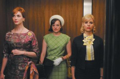 Christina Hendricks as Joan Holloway Harris, Elisabeth Moss as Peggy Olson, and Cara Buono as Faye Miller in Mad Men