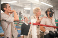 Christian Bale as Dicky Eklund, Mark Wahlberg as Micky Ward, and Melissa Leo as their mother, Alice Ward, in The Fighter