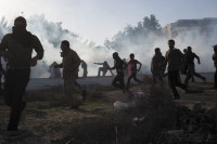 A group of peaceful protesters attacked by police with rubber bullets and tear gas, Diraz, Bahrain, February 14, 2011