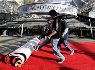 Workers rolling out the red carpet at the Kodak Theatre, Los Angeles, February 23, 2011