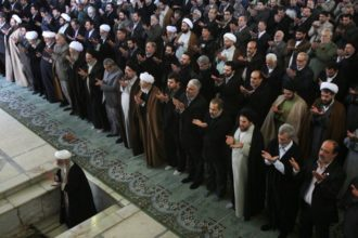 Iranian cleric Ayatollah Ahmad Jannati, left, leads Friday prayers at the Tehran University campus. Jannati said during the prayers that the opposition leaders have lost their reputation among people and are practically