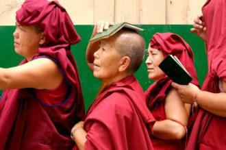 Tibetan Buddhist nuns, holding their mandatory