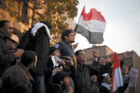 Wael Ghonim (center), the Egyptian Google executive who started the Facebook group 'We Are All Khaled Said,' at a protest in Tahrir Square, Cairo, February 8, 2011