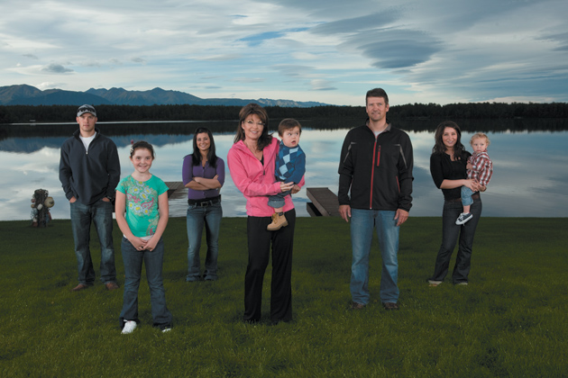 Sarah and Todd Palin with their children Track, Piper, Willow, Trig, and Bristol, who is holding her son Trip, outside their house in Wasilla, Alaska, August 2010; from Sarah Palin's Alaska