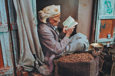 Man reading, Sanaa, Yemen, 1997; photograph by Steve McCurry from his recent book The Unguarded Moment. A collector's edition of his work, Steve McCurry: The Iconic Photographs, will be published by Phaidon this June.