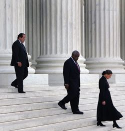 Justices Antonin Scalia, Clarence Thomas, and Ruth Bader Ginsburg leaving the Supreme Court after a ceremony honoring the late Chief Justice William Rehnquist, Washington, D.C., September 2005