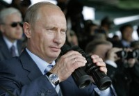 Vladimir Putin watching counter-terrorism exercises, Chebarkul, Russia, August 17, 2007. He is wearing a $10,000 Blancpain Leman Flyback watch, not even among his most expensive.