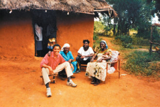 Barack Obama with his stepgrandmother, Sarah, half-sister, Auma, and stepmother, Kezia, at their homestead in Alego, Kenya