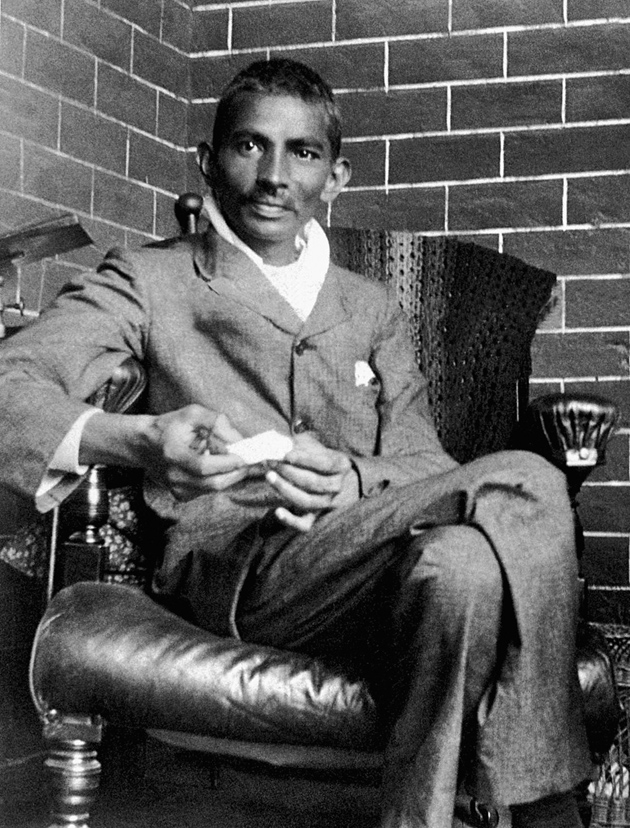 Gandhi in South Africa, recuperating from a severe beating by Pathans on the day he went to register under the 'Black Act' as an Indian living in the Transvaal, 1908; photograph by Joseph Doke, Gandhi's first biographer