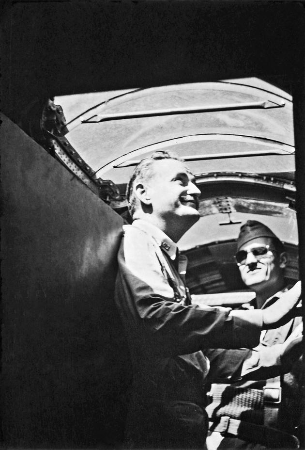 The New York Times war correspondent Barney Darnton (left) examining a B-25 bomber at Amberley Field, Brisbane, Australia, 1942