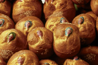 Pan de muerto, described by Diana Kennedy in Oaxaca al Gusto as 'the semisweet yeast rolls of various sizes made for the Day of the Dead, All Saints and All Souls.' Kennedy writes, 'Each one is supposed to represent the soul of a departed family member or friend. The faces illustrated here were just a few of the hundreds being made by Señora Clementina Baños when I visited her one year at the end of October.'