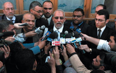 Mohammed Badie, head of the Muslim Brotherhood, speaking to the press outside a polling station in Cairo, March 19, 2011