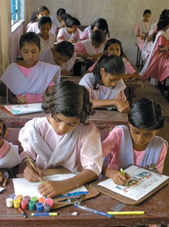 Girls in a classroom in the Indian model village of Ralegan Siddhi, northeast of Pune, Maharashtra, 2006