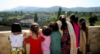 Children looking out over the compound of Osama bin Laden in Abbottabad, Pakistan, May 3, 2011