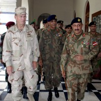 Admiral Michael Mullen, left, arrives in Multan, Pakistan with Pakistan's army Chief General Ashfaq Parvez Kayani, center, to visit flood-affected areas, September 2, 2010