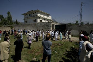 Local people outside the compound where Osama bin Laden was caught and killed late Monday, Abbottabad, Pakistan, May 3, 2011