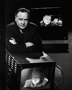Marshall McLuhan with televisions showing his image, circa 1967