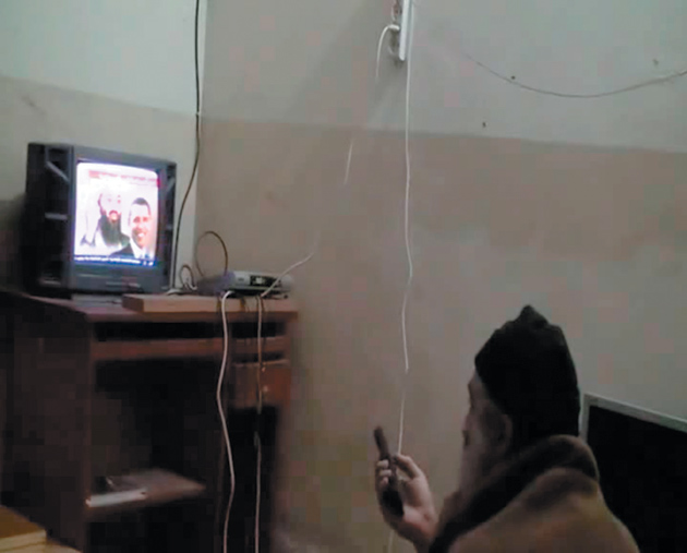 Still from a video of Osama bin Laden watching a newscast about himself and Barack Obama in his Abbottabad compound