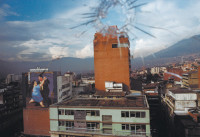 Downtown Medellín viewed through bullet-punctured glass, with a billboard reproduction of a painting by the Colombian artist Fernando Botero at lower left, February 2004