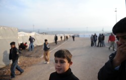 A group of Syrians newly arrived in Turkey on their way to be registered by Turkish military, near the village of Guvecci, Hatay province, Saturday, June 18, 2011.