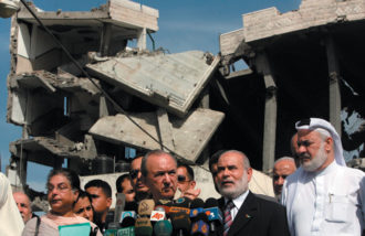 Richard Goldstone (center) at a press conference with Hamas deputy Ahmed Bahr and his delegation in front of the destroyed Palestinian parliament building, Gaza City, June 4, 2009