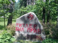 The desecrated memorial stone to the Jews murdered in 1941 at the Ponary Forest, Vilnius, Lithuania, July 2011.  The graffiti reads