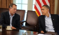 President Barack Obama speaking with House Speaker John Boehner in the Cabinet Room at the White House, July 23, 2011