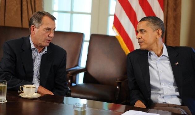 President Barack Obama speaking with House Speaker John Boehner in the Cabinet Room at the White House, July 23, 2011