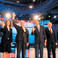 Michele Bachmann, Newt Gingrich, Mitt Romney, and Ron Paul at the first Republican presidential debate for the 2012 election, Manchester, New Hampshire, June 13, 2011