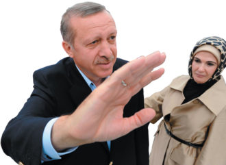 Turkish Prime Minister Recep Tayyip Erdogan and his wife Emine at a campaign rally in Istanbul, June 11, 2011