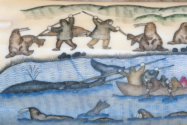 The Chukchi people hunting walruses and whales; ivory tusk engraving from the village museum in Uelen, the easternmost settlement in Russia and Eurasia