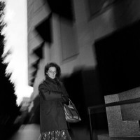 San Francisco, California, 1981: A woman glares at the camera at dusk in the financial district
