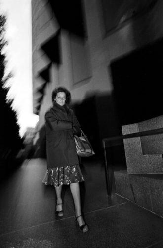 San Francisco, California, 1981: A woman glares at the camera at dusk in the financial district
