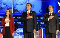 Michele Bachmann, Mitt Romney and Rick Perry during the playing of the National Anthem before a Republican presidential debate,Tampa, Florida, September 12, 2011