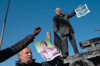Supporters of Muammar Qaddafi protesting in Tripoli, Libya, March 2, 2011