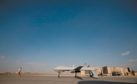 The US Air Force's 62nd Expeditionary Reconnaissance Squadron launching an unmanned Predator drone with laser-guided Hellfire missiles mounted on its wings, Kandahar Air Field, Afghanistan, November 2009