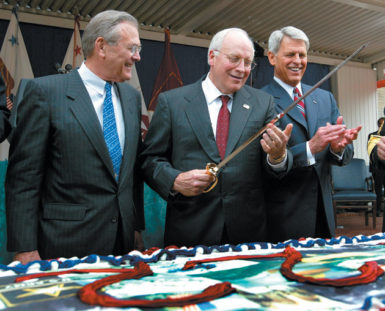 Vice President Dick Cheney cutting a cake, with Secretary of Defense Donald Rumsfeld and Undersecretary of the Army Les Brown, in honor of the Army's 228th anniversary, Washington, D.C., June 13, 2003