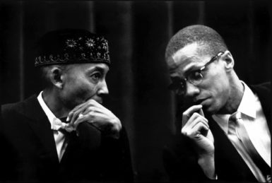 Elijah Muhammad and Malcolm X at a Nation of Islam rally, 1961