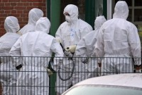 Investigators of the Federal Agency for Radiation Protection examining traces of radiation linked to poisoning of Alexander Litvinenko by polonium, Haselau, west of Hamburg, Dec 13, 2006