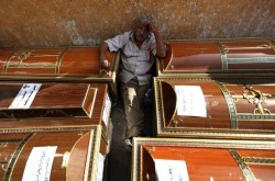 A relative of one of the Copts killed in the violence on October 9 mourning over his coffin outside the morgue of the Copts hospital, Cairo Oct. 10, 2011